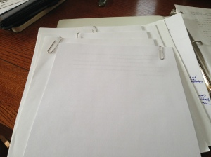 When I'm currently working on a draft, I keep them together with paperclips. They'll eventually go into the binder when I've retyped the draft. I flipped the top one over because it's top secret.